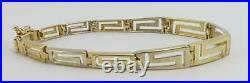 14K yellow gold ladies art deco 7 link bracelet 9.5g
