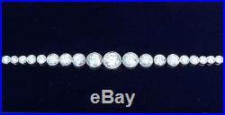 Stunning art deco solid platinum graduated 4.80ct diamond tennis bracelet